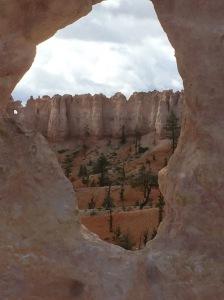 Hoodoos through a sandstone window